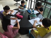 Students doing their own work before their lessons starts. There is a holding area for students to do quiet work and catch up with some studying before attending their class. eduKateSG Primary Students at Tampines