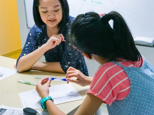 Tutor Yuet Ling teaching students Creative Writing English class.
